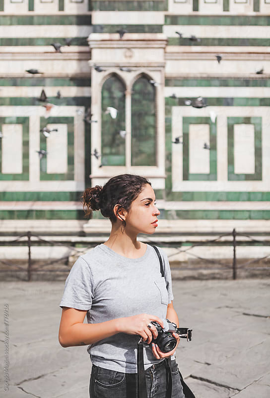 Young Photographer with Analog Camera in front of an Old Italian Church by Giorgio Magini for Stocksy United