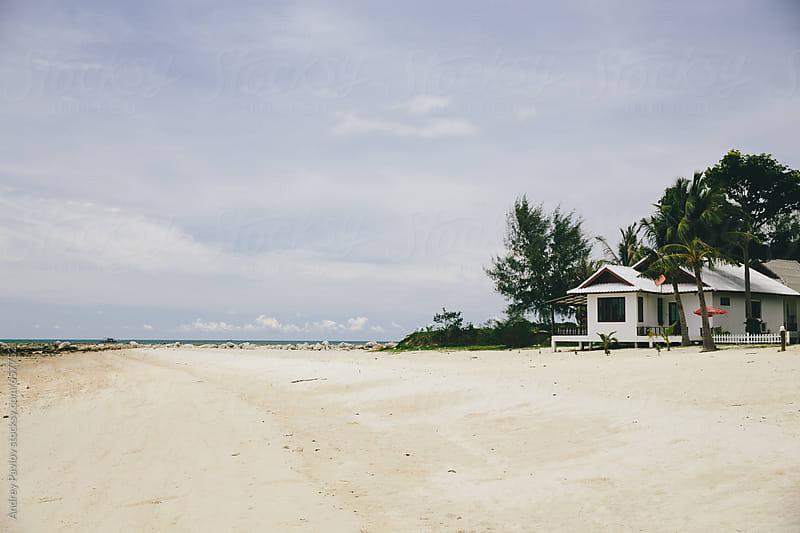 White houses on deserted beach by Andrey Pavlov for Stocksy United