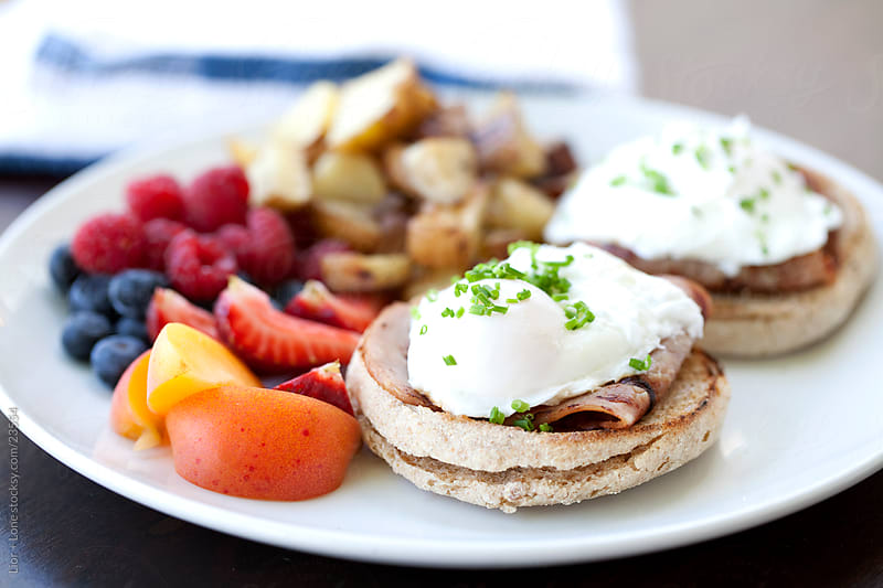 Eggs Benedict on English muffins by Lior + Lone for Stocksy United