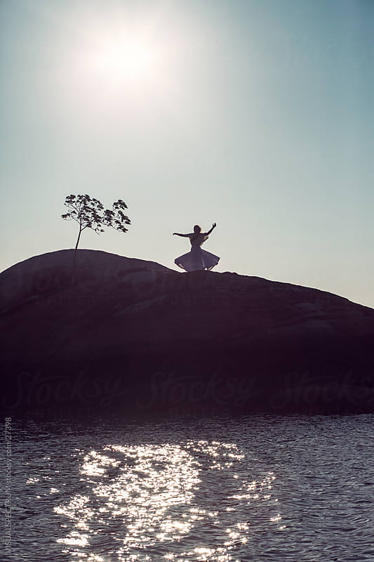 Young Woman Dancing Under the Open Sky by VISUALSPECTRUM for Stocksy United
