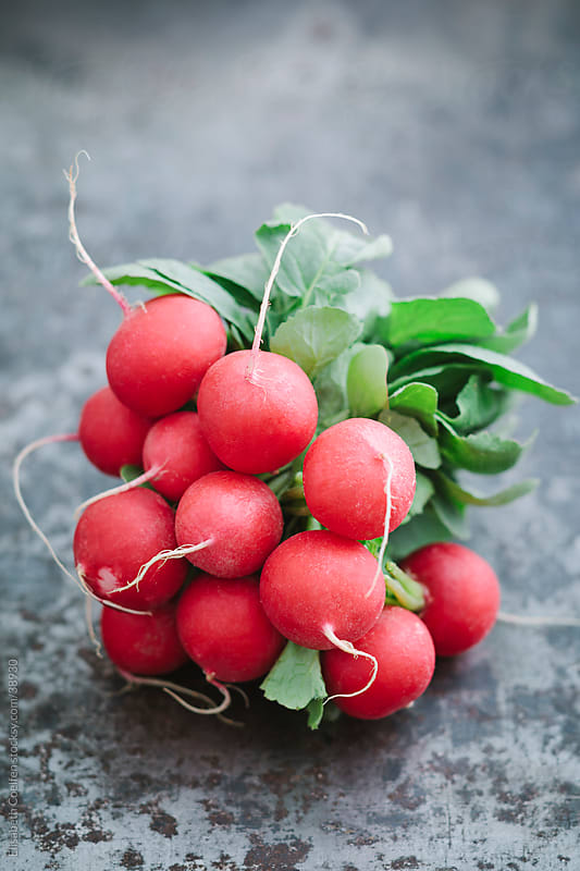 A bunch of fresh radish on metal rustic table by Elisabeth Coelfen for Stocksy United