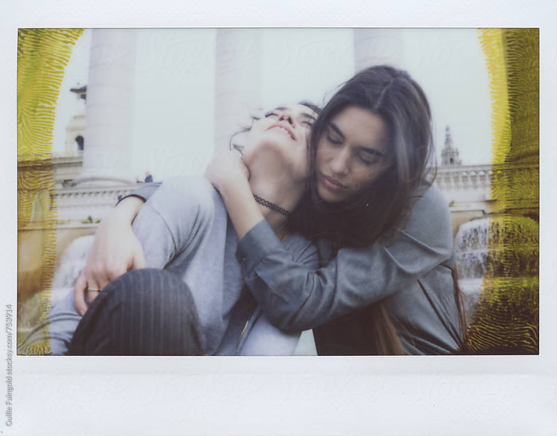 two women kissing by Guille Faingold for Stocksy United