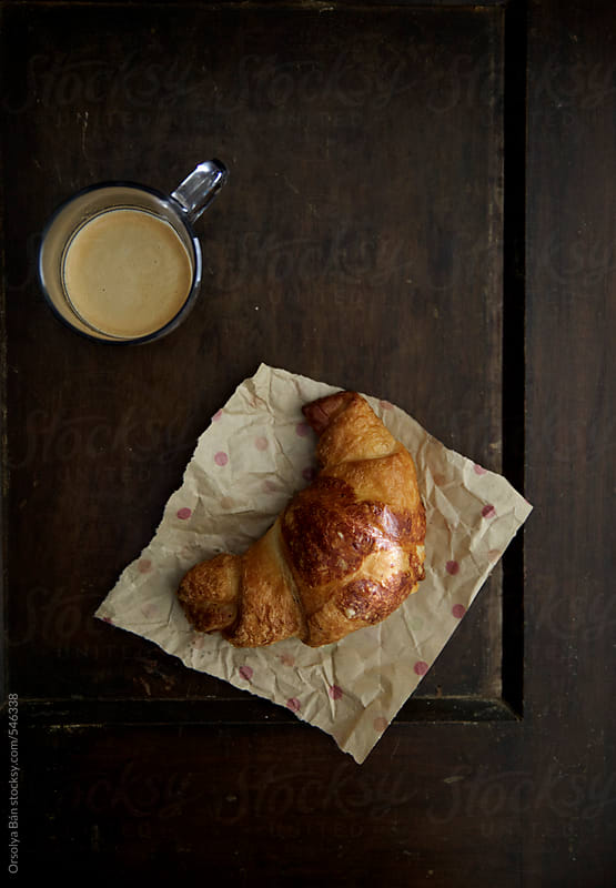 Croissant and coffee by Orsolya Bán for Stocksy United
