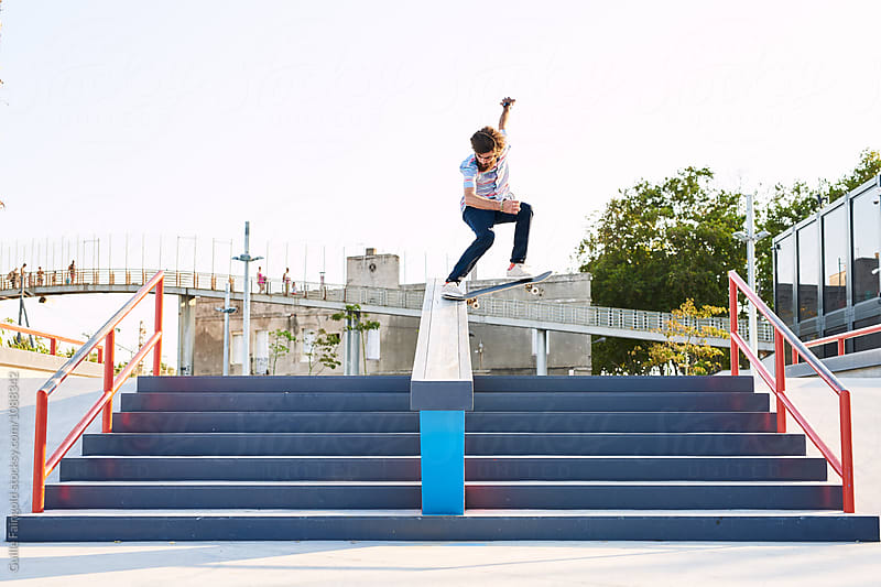 skater performing extreme tricks in park by Guille Faingold for Stocksy United