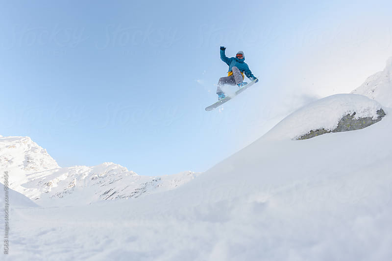 Cool snowboarder in midair  by RG&B Images for Stocksy United