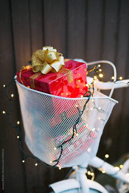 Christmas gifts in a bicycle basket by Jovana Rikalo for Stocksy United