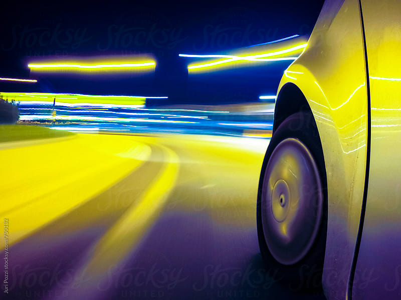 Car driving fast in the night city by Juri Pozzi for Stocksy United