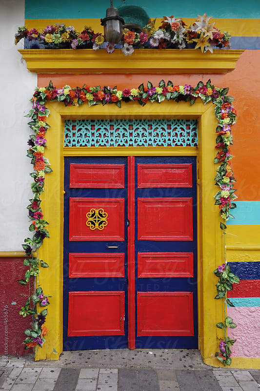 Colorful door decorated with flowers in Medellin, Colombia by Per Swantesson for Stocksy United