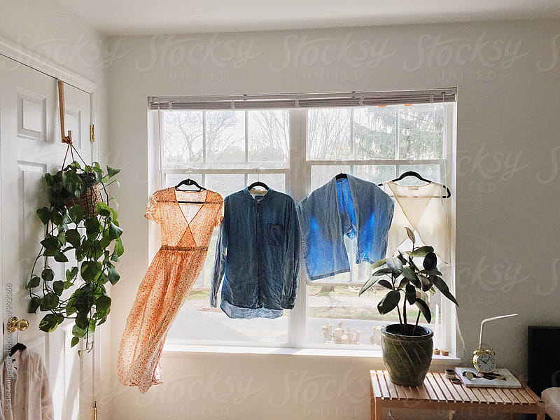 Laundry Blowing In Window by Sadie Culberson for Stocksy United