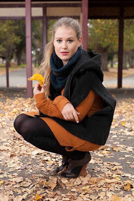 Stylish woman in autumn park by Ben Ryan for Stocksy United
