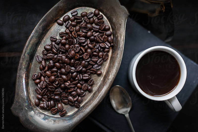 Coffee beans and black coffee.  by Darren Muir for Stocksy United