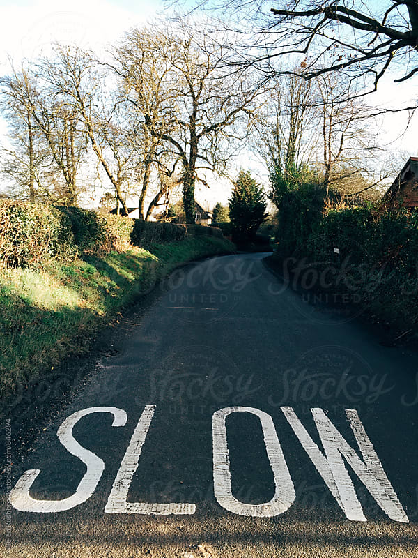 Slow painted on a country road.  by Helen Rushbrook for Stocksy United