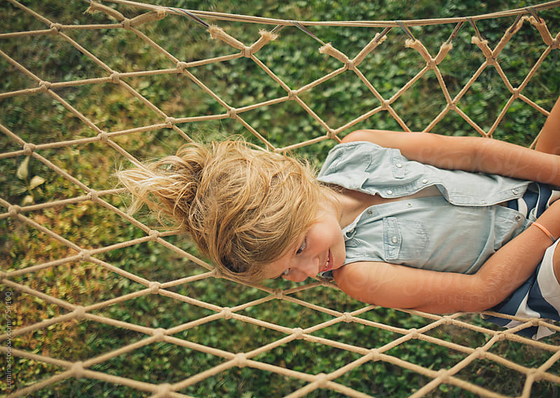 Cute Blonde Girl Lying in a Hammock by Lumina for Stocksy United