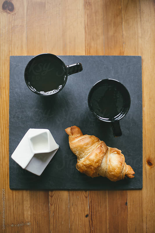 Croissant and Tea by Lumina for Stocksy United