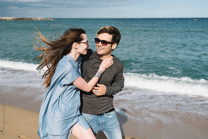 Young couple enjoying the sea by GIC for Stocksy United