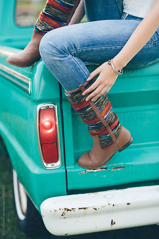 young woman with stylish boots by Brian Powell for Stocksy United