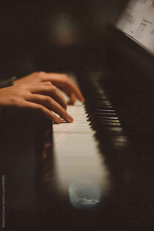 Child's Hands Playing Piano by Ronnie Comeau for Stocksy United