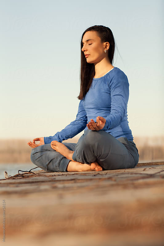 Woman meditating in nature. by Mosuno for Stocksy United