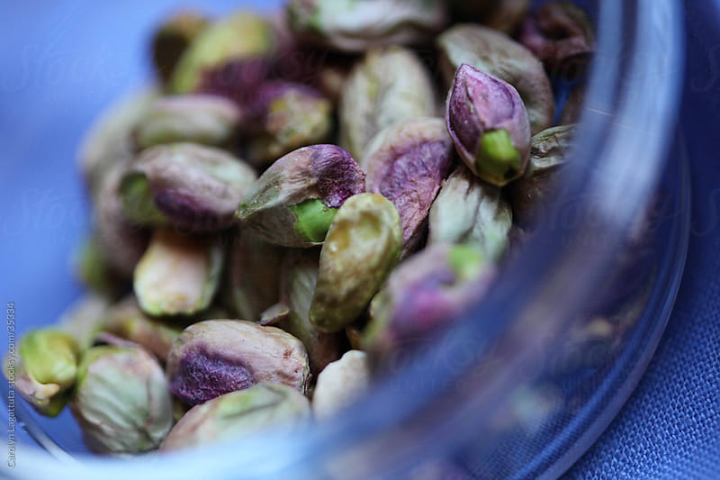 A close up of pistachios in a bowl by Carolyn Lagattuta for Stocksy United
