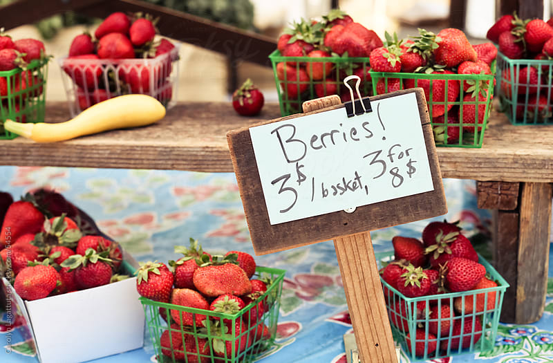 Organic berries for sale at the farmer's market by Carolyn Lagattuta for Stocksy United