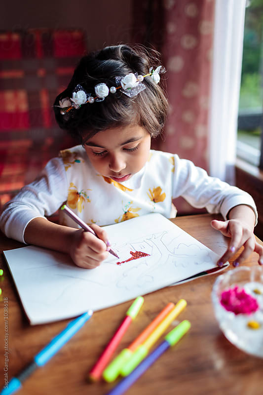 Little girl drawing by Saptak Ganguly for Stocksy United