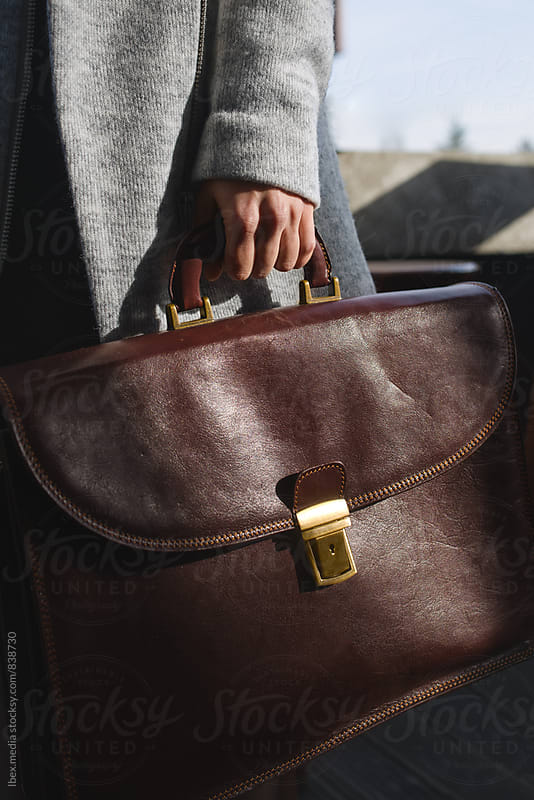 Woman holding business briefcase by RG&B Images for Stocksy United