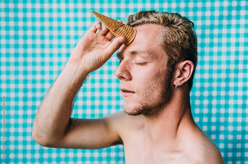 man with a horn on his head by Thais Ramos Varela for Stocksy United