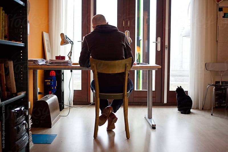 Designer working at his desk at home by Ivo de Bruijn for Stocksy United