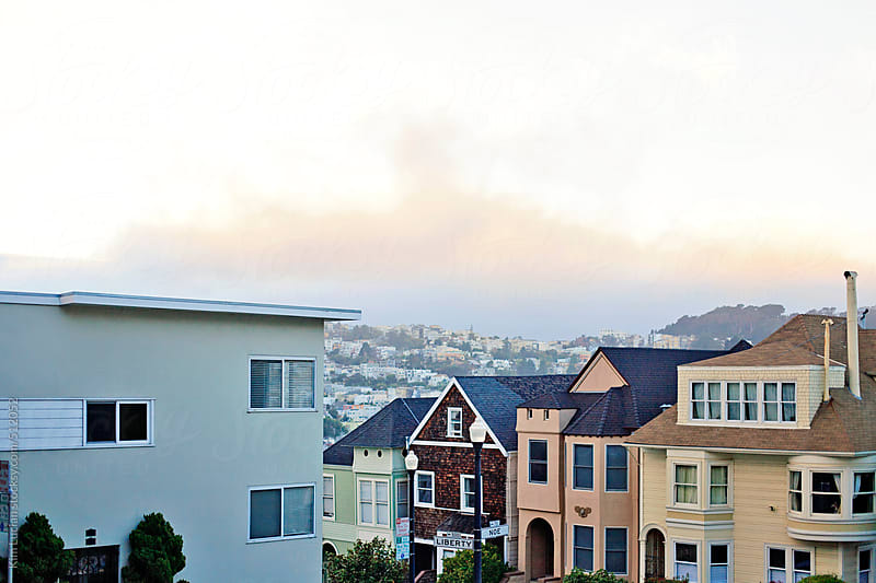 View of Fog between Houses in San Francisco by Kim Lucian for Stocksy United