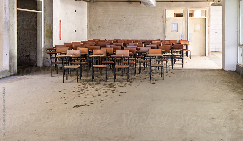 Empty school desks by Gabriel Diaz for Stocksy United