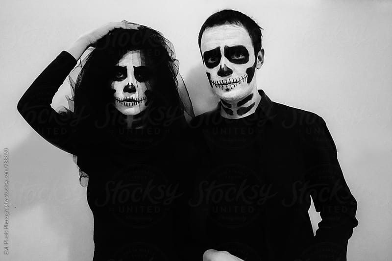 Young couple preparing for halloween by Evil Pixels Photography for Stocksy United