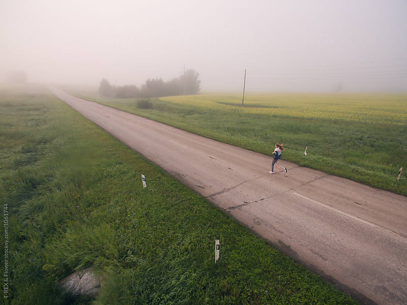 Aerial view with drone of running woman in morning countryside by T-REX & Flower for Stocksy United