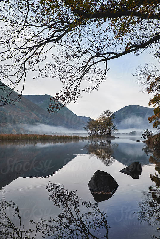 Reflections and fog at sunrise. Brothers Water, Cumbria, UK. by Liam Grant for Stocksy United