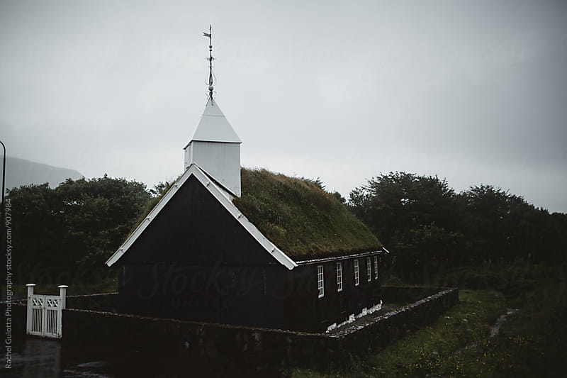 Grass Roofed Black and White Gothic Church in the Faore Islands by Rachel Gulotta Photography for Stocksy United