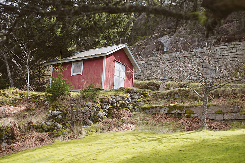 Small wodden hut in Sweden by Jonas Räfling for Stocksy United