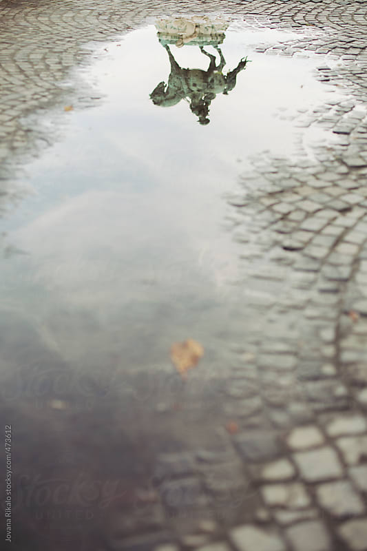 Statue puddle reflection by Jovana Rikalo for Stocksy United