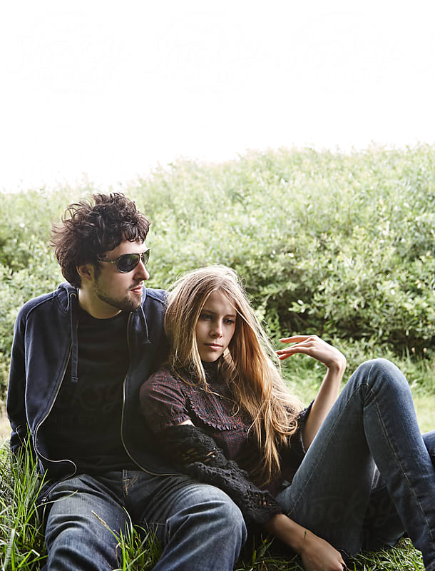Couple relaxing in nature in California  by Trinette Reed for Stocksy United
