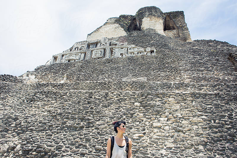 Woman with Mayan Temple Background by Meg Pinsonneault for Stocksy United