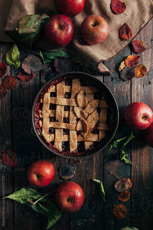 Rustic apple pie on wooden table by Nataša Mandić for Stocksy United
