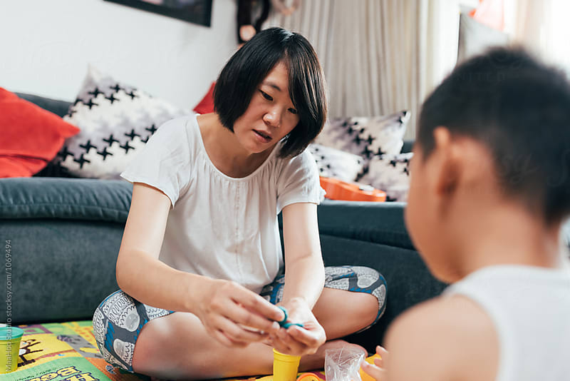 Pregnant mother and son playing at home by MaaHoo Studio for Stocksy United