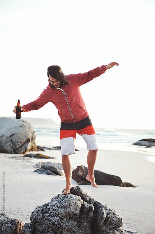 beach beer man by Daxiao Productions for Stocksy United