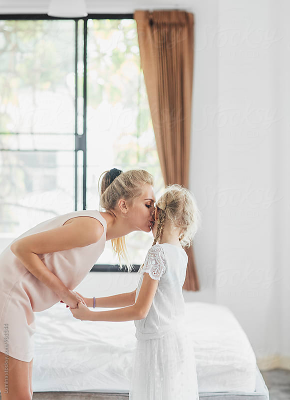 Mother Kissing Her Daughter by Lumina for Stocksy United