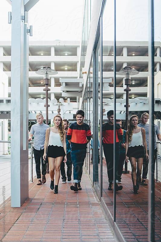 Young People Walking Around Downtown by Stephen Morris for Stocksy United