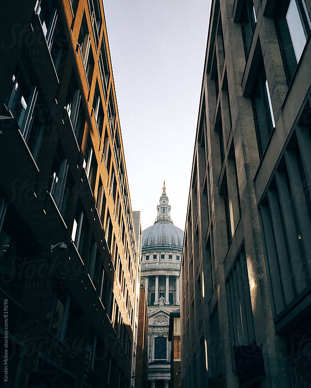 View of St. Paul's down an avenue of streets, London by Kirstin Mckee for Stocksy United