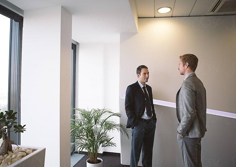 Businessmen Chatting by Lumina for Stocksy United