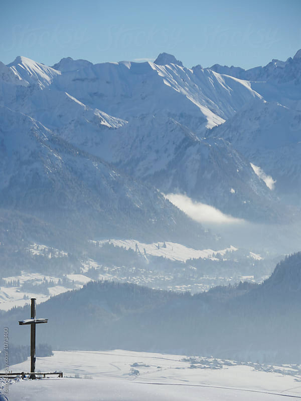 Great mountains covered with snow by rolfo for Stocksy United