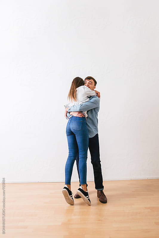 Happy couple embracing. by BONNINSTUDIO for Stocksy United