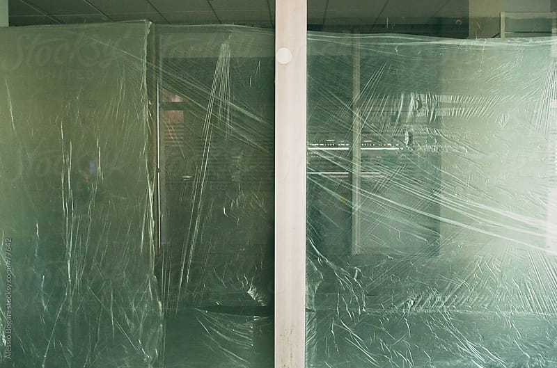 Empty vacant office wrapped window by Alessio Bogani for Stocksy United