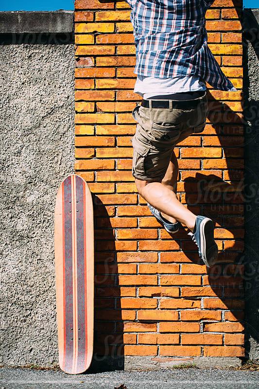 Boy jumping on a wall by michela ravasio for Stocksy United