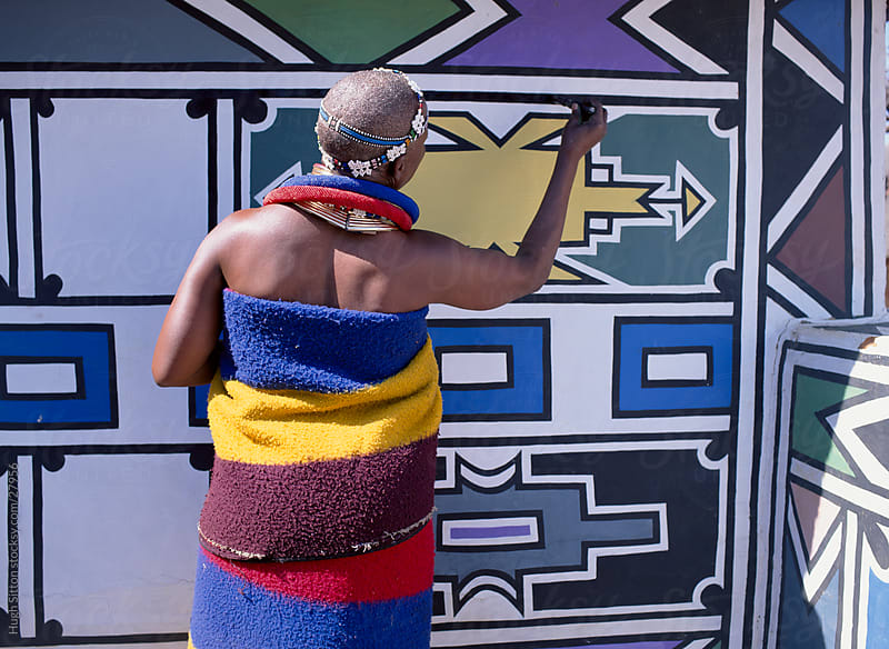 Ndebele Tribeswoman decorating her home. South Africa by Hugh Sitton for Stocksy United